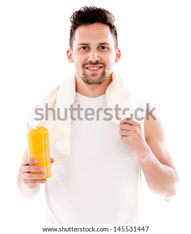 Happy gym man drinking water after workout - isolated over white  - stock photo