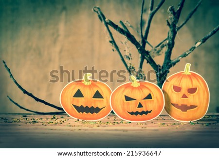 Happy Halloween pumpkin on wood. - stock photo
