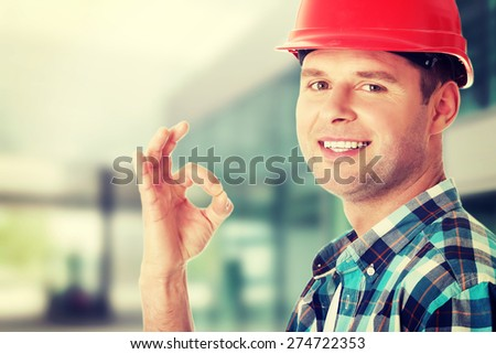 Happy handsome engineer gesturing OK - stock photo