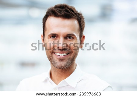 Happy handsome young man smiling. - stock photo