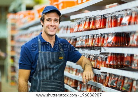 happy hardware store worker looking at the camera - stock photo