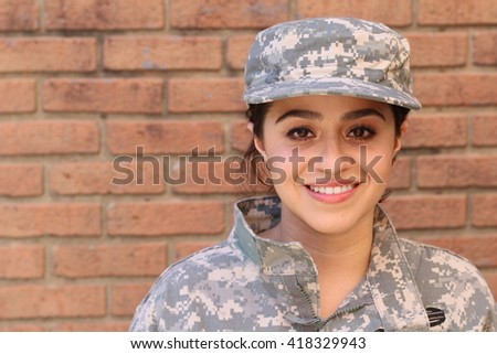 Happy healthy ethnic army female soldier - stock photo