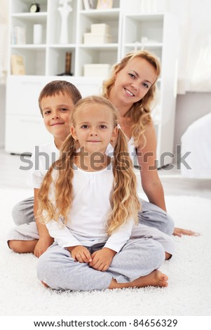 Happy healthy people at home portrait - kids and their mother - stock photo