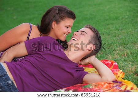 happy healthy young couple outdoors concept for fresh breath - stock photo