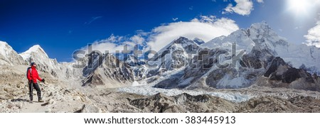 Happy hiker on Everest Base Camp trek, freedom and happiness, achievement in mountains. Mount Everest and Nuptse view in Sagarmatha National Park in the Nepal Himalaya - stock photo