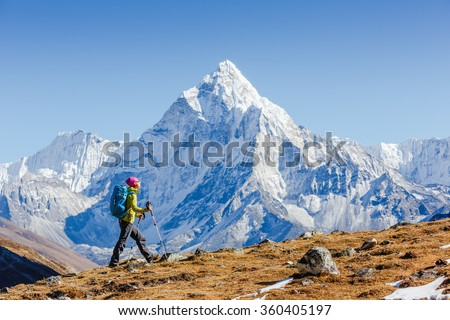 Happy hiker walking in the mountains, freedom and happiness, achievement in mountains. Himalayas, Everest Base Camp trek, Nepal - stock photo