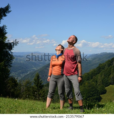 Happy hikers family on a mountain pass - stock photo