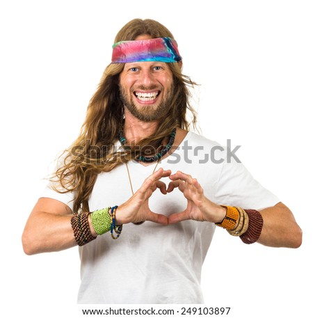 Happy hippie man holding his hands in a love heart over his chest. Isolated on white. - stock photo