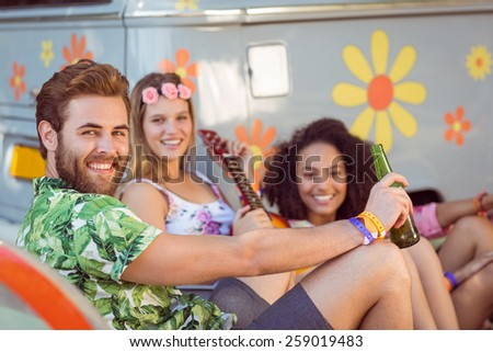 Happy hipsters relaxing on campsite at a music festival - stock photo