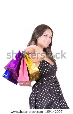 Happy hispanic  female shopper holding shopping bags - isolated over white - stock photo