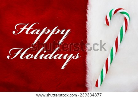 Happy Holidays, A plush red stocking with a candy cane and words Happy Holidays - stock photo