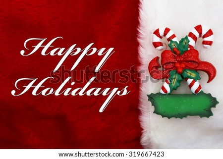 Happy Holidays, A plush red stocking with Candy Canes and words Happy Holidays - stock photo