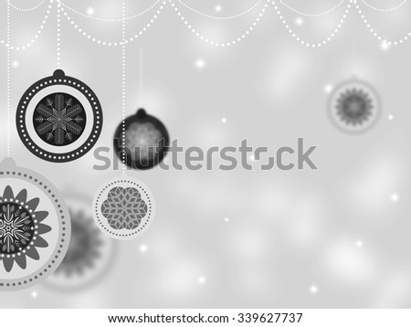 Happy Holidays Black and White Card. Beautiful Winter Concept with New Year Balls and Snowflakes on Blurred Defocused Background. Happy New Year and Merry Christmas Elegant Design. - stock photo