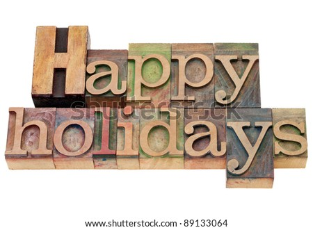 happy holidays - isolated text in vintage wood letterpress printing blocks - stock photo