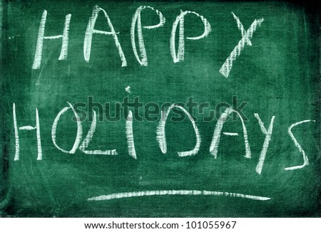 happy holidays written with chalk on chalkboard - stock photo