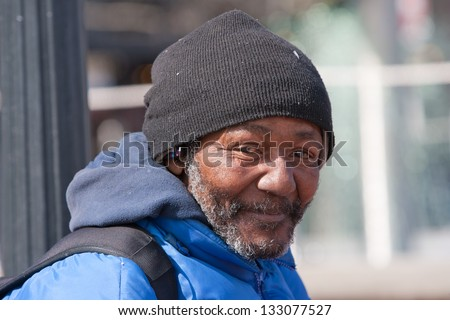 Happy homeless african american man outdoors during the day. - stock photo