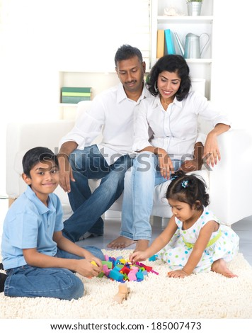 happy indian family enjoying quality time indoor - stock photo