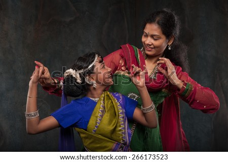 happy Indian family , mother instills daughter of folk culture - stock photo