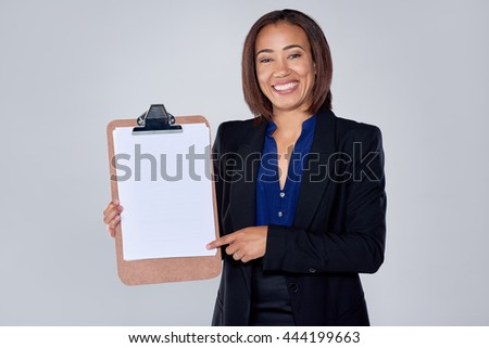 Happy indian hispanic latino mixed race corporate business woman holding clipboard with copy space - stock photo