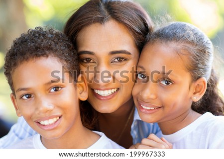 happy indian mother and her adorable kids closeup portrait - stock photo