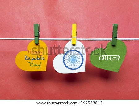 Happy Indian Republic Day 26 January concept. India flag (heart color) hanging on pegs ( clothespin ) with text Vande Mataram in national tricolour flag and ashoka.  - stock photo