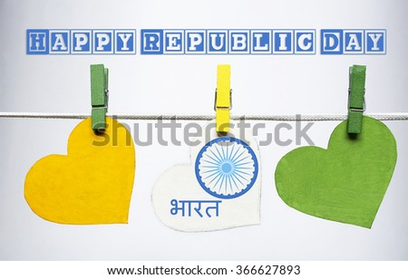 Happy Indian Republic Day on Hindi language. 26 January concept. India flag (heart color) hanging on pegs ( clothespin ) with text Vande Mataram in national tricolour flag and ashoka. - stock photo