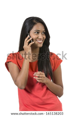 Happy Indian Woman using a smartphone. Isolated over a white background - stock photo