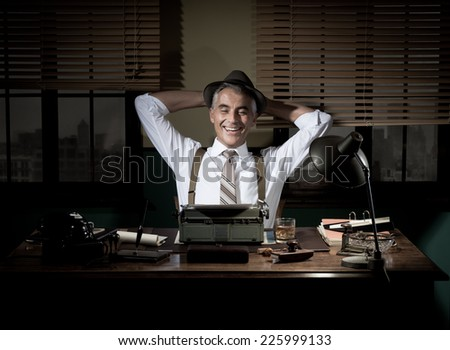 Happy journalist smiling and having a break late at night with hands behind head. - stock photo