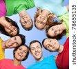 Happy joyful friends forming a circle of head - stock photo