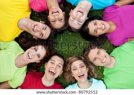 Happy joyful group of young friends enjoy together the life outdoor - stock photo