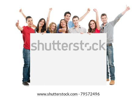 Happy joyful large group of friends displaying white placard for your text isolated on white background - stock photo