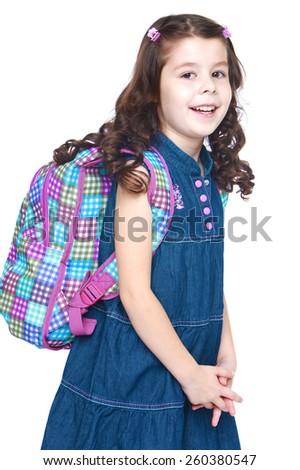 Happy joyful little girl goes to school - isolated on white. - stock photo