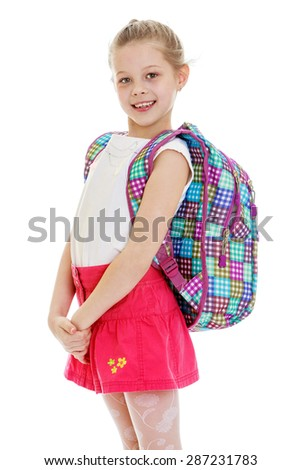 Happy joyful schoolgirl in red skirt and school satchel over his shoulder-Isolated on white background - stock photo