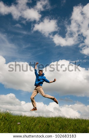 Happy jumping man outdoor in the fields - stock photo