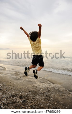 Happy jumping on sea - stock photo
