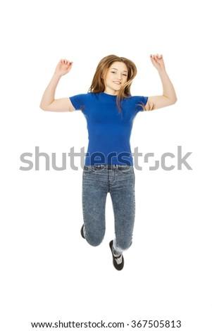 Happy jumping teenager. - stock photo
