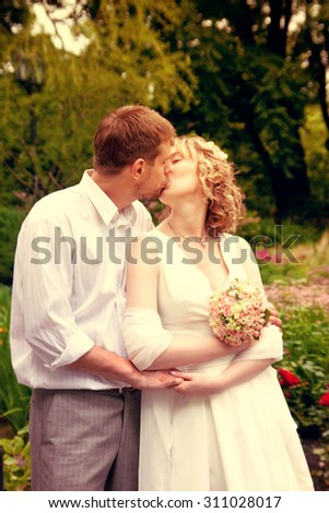 Happy just married couple kissing - stock photo