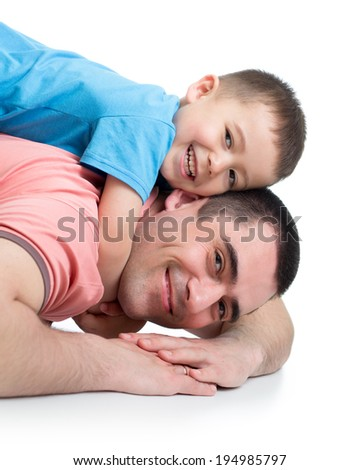 Happy kid boy and his dad lying on the floor - stock photo
