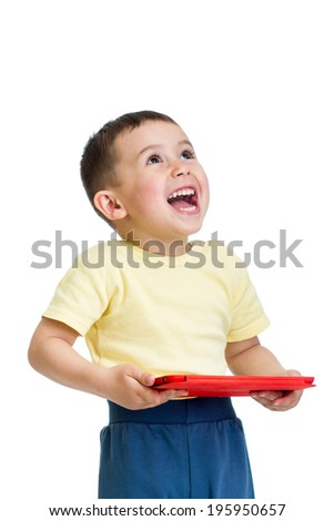 happy kid boy playing with pc tablet and looking up - stock photo