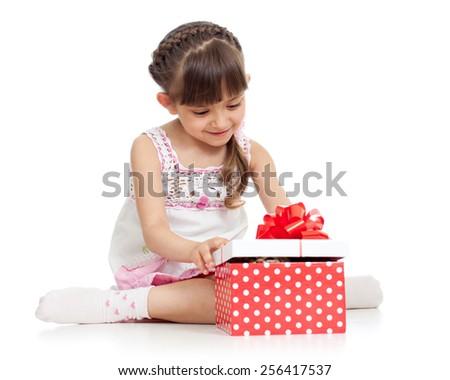 happy kid girl holding gift box isolated on white - stock photo