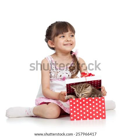 happy kid girl opening gift box with cat kitten - stock photo