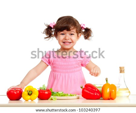 happy kid girl preparing healthy food - stock photo