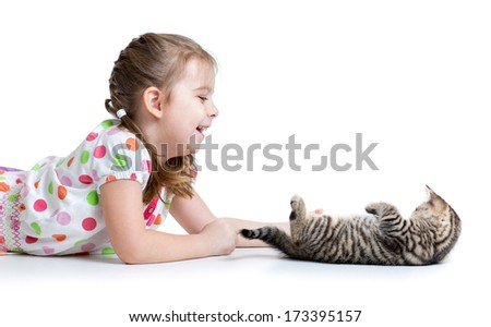 happy kid lying on floor and playing with cat kitten - stock photo