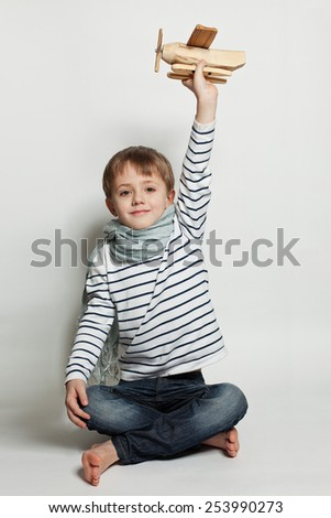 Happy kid play toys - stock photo