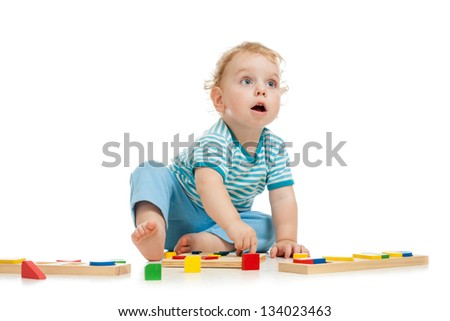 happy kid playing toys - stock photo