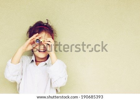 Happy kid playing with binoculars. explore and adventure concept  - stock photo