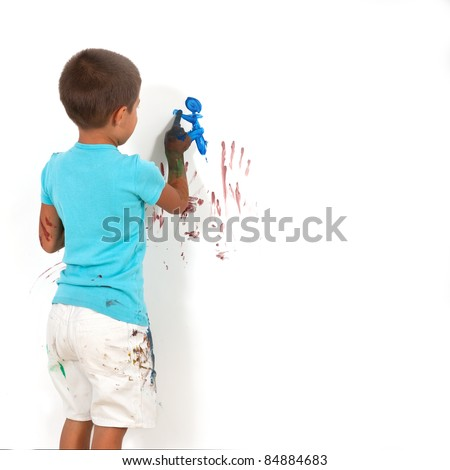 Happy kid playing with colors. - stock photo