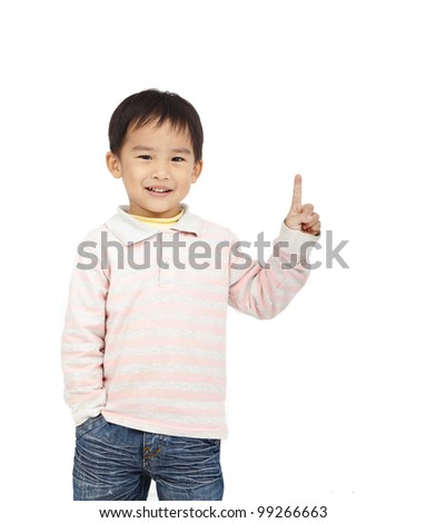 happy kid pointing space - stock photo