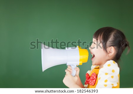 happy kid shouts something into the megaphone - stock photo