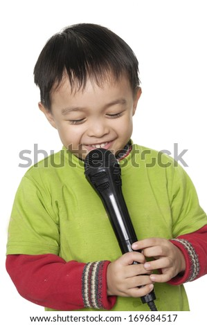 Happy Kid singing, with black microphone ,isolated - stock photo